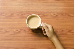 Hand holding coffee cup Royalty Free Stock Image