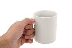 Hand holding coffee mug royalty free stock photography