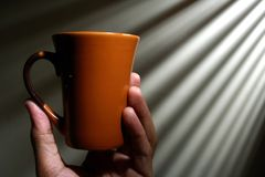 Hand holding a coffee mug Stock Photography