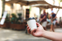 Hand holding coffee to take away Royalty Free Stock Image