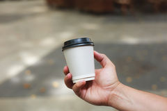 Hand holding coffee to take away Royalty Free Stock Photo