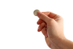 Hand holding coin. On white background Royalty Free Stock Photo