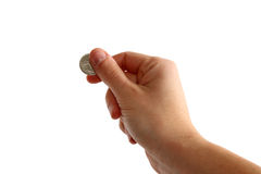 Hand holding coin. On white background Royalty Free Stock Images