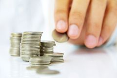 Hand holding coin stack Stock Images