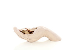 Hand holding coins Stock Images