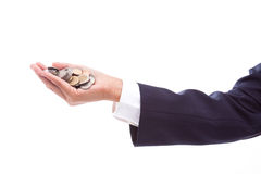 Hand holding coins Stock Image