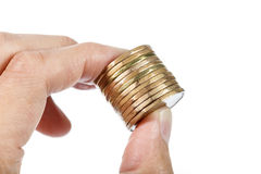 Hand holding coins Royalty Free Stock Photography
