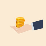 A hand holding coins. Hand holding a pile of golden coins Stock Photo