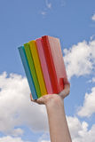 Hand holding color books Royalty Free Stock Images