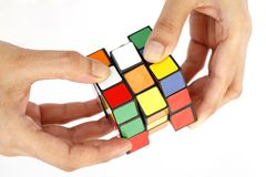 Hand holding color cube Royalty Free Stock Images