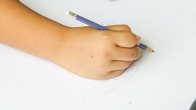 Hand holding color pencil on the paper Stock Photos