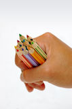 Hand holding the color pencils. Kid's hand holding color pencils royalty free stock image
