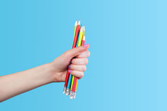 Hand holding color pencils Stock Photo