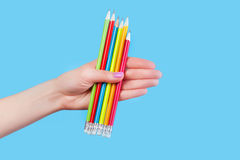 Hand holding color pencils Royalty Free Stock Images
