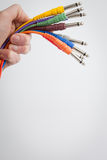 Hand holding color wires. On a white background Stock Photos