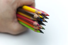 Hand holding colored pencils. Stock Photography