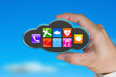 Hand holding colorful app icons on black cloud with sky Stock Photography