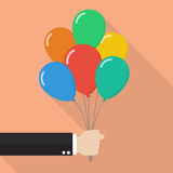 Hand holding colorful balloons Stock Photography