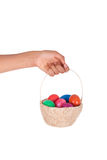Hand holding colorful Easter eggs in the basket Stock Image