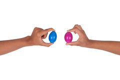 Hand holding colorful Easter eggs in the basket Stock Photography