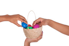 Hand holding colorful Easter eggs in the basket Royalty Free Stock Images