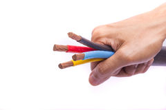 Hand holding colorful electrical cables Royalty Free Stock Photos