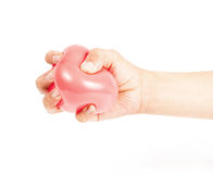 Hand holding colorful helium balloons isolated Stock Images