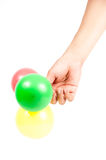 Hand holding colorful helium balloons isolated Stock Image