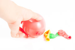 Hand holding colorful helium balloons  Royalty Free Stock Photography