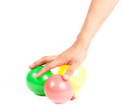 Hand holding colorful helium balloons  Stock Photo