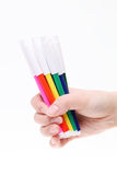 Hand holding colorful pens Stock Image