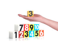 Hand holding colorful plastic numbers on white background ,No1 Royalty Free Stock Photos