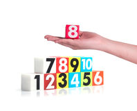 Hand holding colorful plastic numbers on white background ,No1 Royalty Free Stock Image
