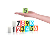 Hand holding colorful plastic numbers on white background ,No1 Stock Photo