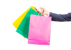 Hand holding colorful shopping bags Royalty Free Stock Image