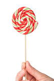 Hand holding colorful spiral lollipop Stock Images