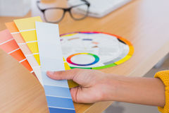 Hand holding colour swatches Stock Photo