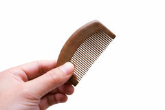 Hand holding Comb isolated on a white background. Hand holding Comb on white background Royalty Free Stock Photography