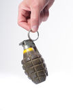 Hand holding a combat pineapple grenade Royalty Free Stock Photos