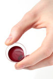 Hand Holding a Communion Cup stock image