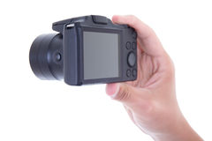 Hand holding compact digital camera with blank screen isolated o Royalty Free Stock Photo