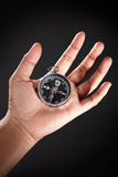 Hand holding compass Stock Photo