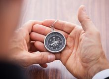 Hand holding compass Royalty Free Stock Photo