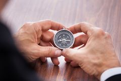 Hand holding compass Stock Photography