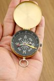Hand holding compass Stock Images