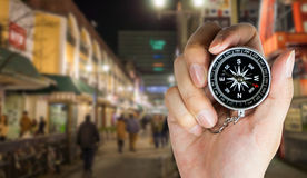Hand holding compass for direction. In fukuoka japan stock photo