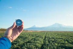 Hand holding compass in front of Ararat mountain background. Travel, Armenia royalty free stock photos