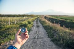 Hand holding compass in front of Ararat mountain background. Travel, Armenia stock photos