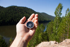 Hand holding the compass Royalty Free Stock Photography