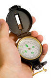Hand Holding Compass On White Royalty Free Stock Photos